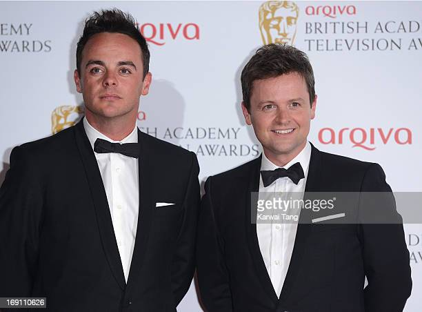 Anthony McPartlin and Declan Donnelly pose in the press room at the Arqiva British Academy Television Awards 2013 at the Royal Festival Hall on May...