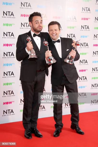 Anthony McPartlin and Declan Donnelly pose in the press room with the The Bruce Forsyth Entertainment Award and TV Presenter Award at the National...