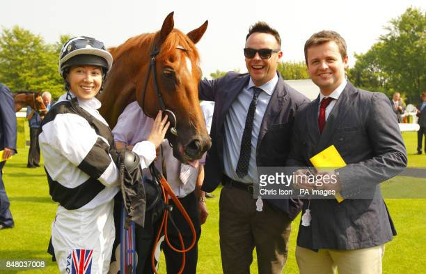 Anthony McPartlin and Declan Donnelly with jockey Hayley Turner rider of their horse Primaeval after winning the Wright Joinery Company Stakes during...
