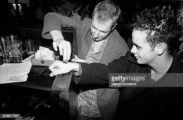 Anthony McPartlin of Ant and Dec has his hand stmped on the door at the Dublin Castle pub and gig venue Camden Town London United Kingdom 1994