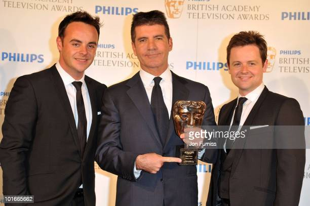 Anthony McPartlin Simon Cowell and Declan Donnelly pose in the press room at the Philips British Academy Television Awards at London Palladium on...