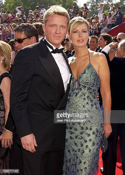 Anthony Michael Hall and Sandra Guerard during The 55th Annual Primetime Emmy Awards Arrivals at The Shrine Theater in Los Angeles California United...