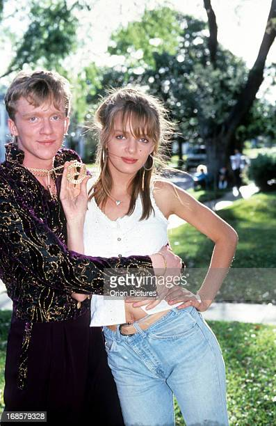 Anthony Michael Hall holds Uma Thurman on set of the film 'Johnny Be Good' 1988