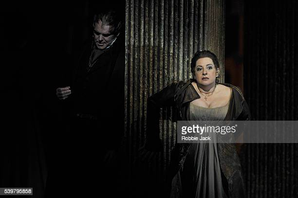 """Anthony Michaels-Moore as Baron Scarpia and Claire Rutter as Floria Tosca in the English National Opera's production of Giacomo Puccini's """"Tosca""""..."""