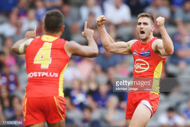 Anthony Miles of the Suns celebrates a goal during the round three AFL match between the Western Bulldogs and the Gold Coast Suns at Marvel Stadium...