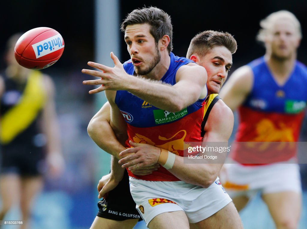 Anthony Miles of the Tigers tackles Ryan Bastinac of the Lions during the round 17 AFL match between the Richmond Tigers and the Brisbane Lions at Etihad Stadium on July 16, 2017 in Melbourne, Australia.