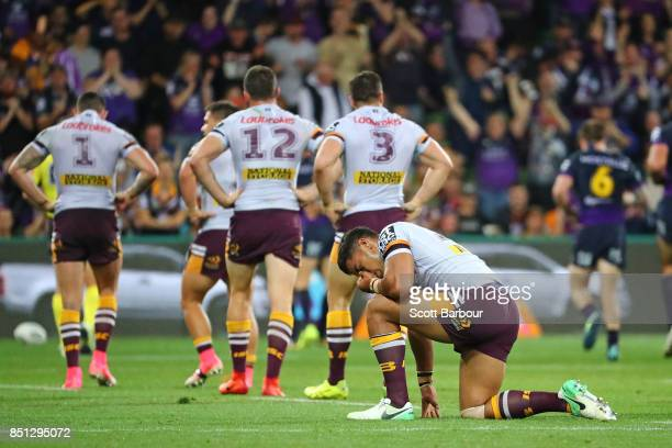 Anthony Milford and the Broncos look dejected as Josh AddoCarr of the Storm runs away to score the first try during the NRL Preliminary Final match...