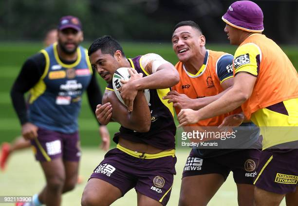 Anthony Milford attempts to break through the defence during the Brisbane Broncos NRL training session on March 15 2018 in Brisbane Australia