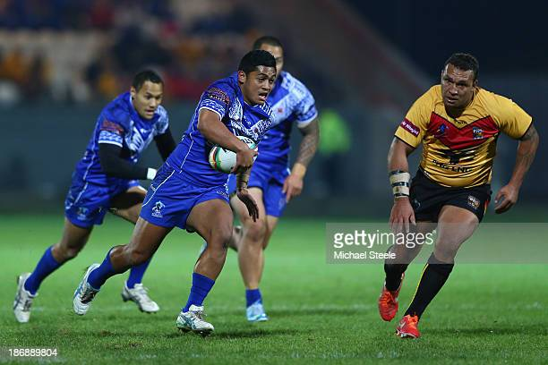 Anthony Milford of Samoa bursts clear during the Rugby League World Cup Group B match between Papua New Guinea and Samoa at Craven Park Stadium on...