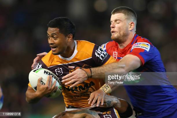 Anthony Milford of the Brisbane Broncos is tackled during the round 15 NRL match between the Newcastle Knights and the Brisbane Broncos at McDonald...