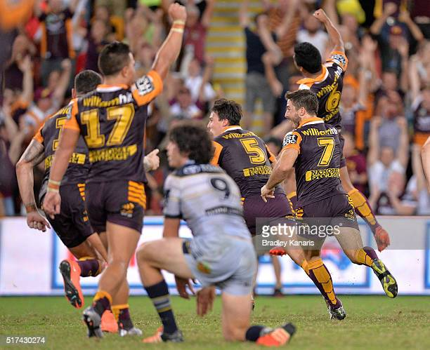 Anthony Milford of the Broncos and team mates celebrate victory after Anthony Milford kicks the winning field goal in golden point extra time during...