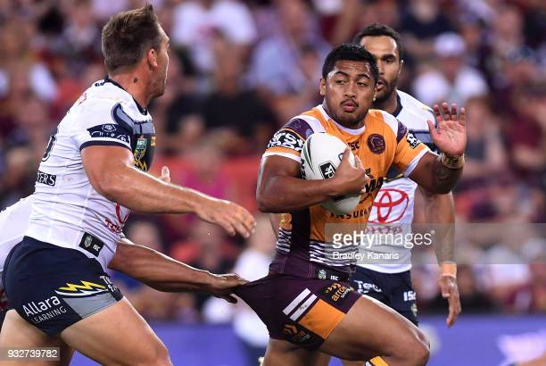 Anthony Milford of the Broncos attempts to break away from the defence during the round two NRL match between the Brisbane Broncos and the North...