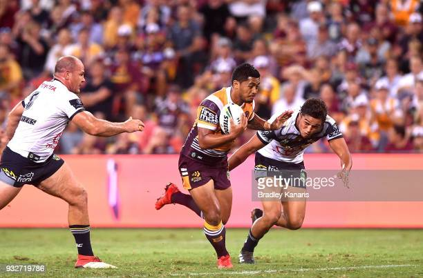 Anthony Milford of the Broncos breaks away from the defence during the round two NRL match between the Brisbane Broncos and the North Queensland...