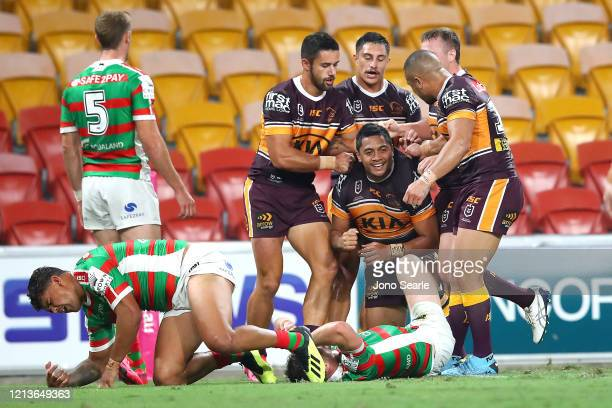 Anthony Milford of the Broncos celebrates a try with team mates during the round 2 NRL match between the Brisbane Broncos and the South Sydney...