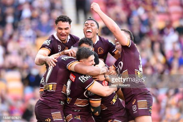 Anthony Milford of the Broncos celebrates scoring a try with team mates during the round 25 NRL match between the Brisbane Broncos and the Newcastle...
