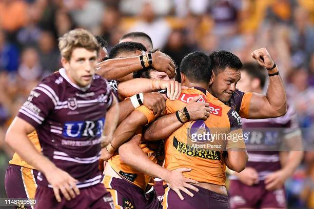 Anthony Milford of the Broncos celebrates with team mates after scoring his team's first try during the round nine NRL match between the Manly Sea...