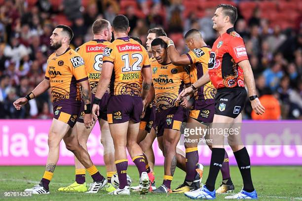 Anthony Milford of the Broncos is congratulated by team mates after scoring a try during the round ten NRL match between the Manly Sea Eagles and the...