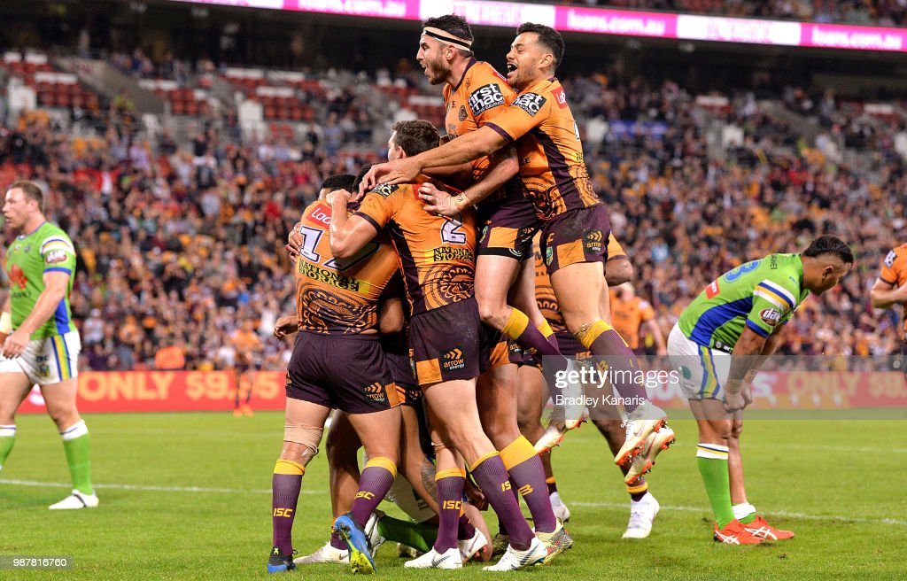 Anthony Milford of the Broncos is congratulated by team mates after scoring a try during the round 16 NRL match between the Brisbane Broncos and the Canberra Raiders at Suncorp Stadium on June 30, 2018 in Brisbane, Australia.