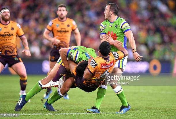 Anthony Milford of the Broncos is picked up in the tackle during the round 16 NRL match between the Brisbane Broncos and the Canberra Raiders at...