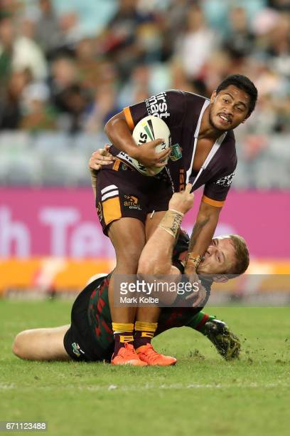 Anthony Milford of the Broncos is tackled by George Burgess of the Rabbitohs during the round eight NRL match between the South Sydney Rabbitohs and...