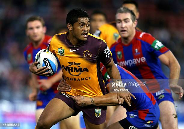 Anthony Milford of the Broncos is tackled during the round 11 NRL match between the Newcastle Knights and the Brisbane Broncos at Hunter Stadium on...