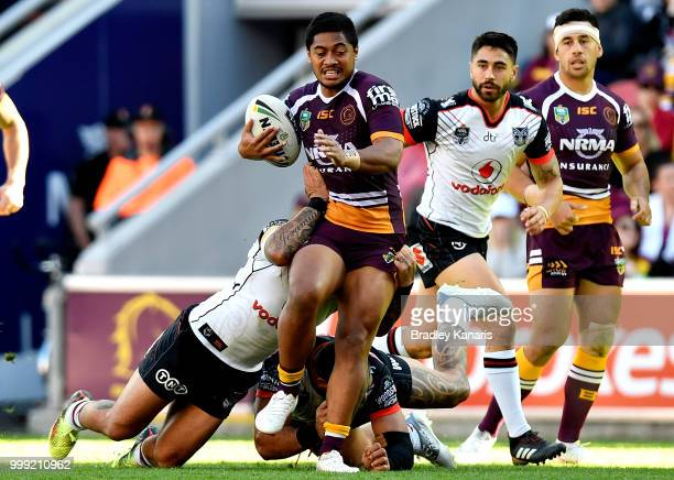 Anthony Milford of the Broncos is tackled during the round 18 NRL match between the Brisbane Broncos and the New Zealand Warriors at Suncorp Stadium...