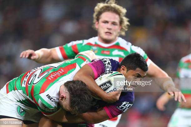 Anthony Milford of the Broncos is tackled during the round 23 NRL match between the Brisbane Broncos and the South Sydney Rabbitohs at Suncorp...