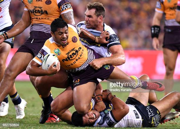 Anthony Milford of the Broncos is tackled during the round two NRL match between the Brisbane Broncos and the North Queensland Cowboys at Suncorp...