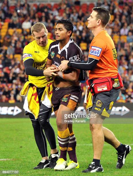 Anthony Milford of the Broncos is taken from the field injured during the round 14 NRL match between the Brisbane Broncos and the South Sydney...