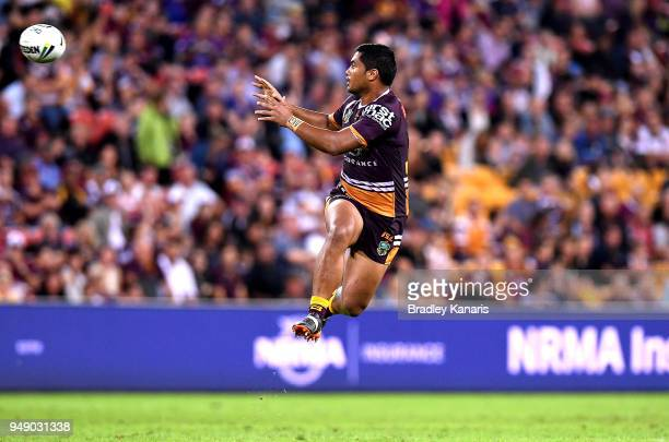 Anthony Milford of the Broncos jumps up to catch the ball during the round seven NRL match between the Brisbane Broncos and the Melbourne Storm at...
