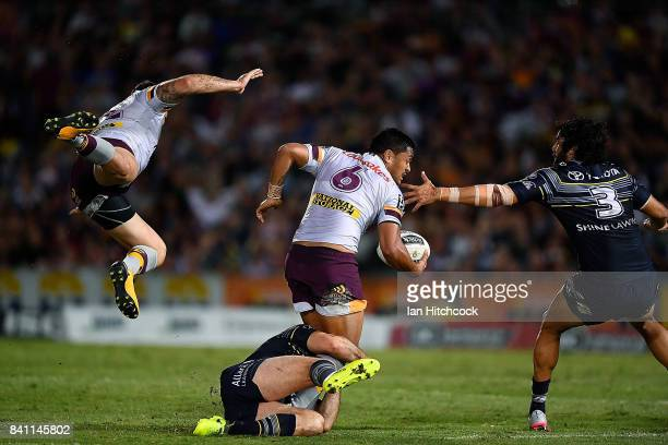 Anthony Milford of the Broncos looks to get a pass away next to a flying Matt Gillett of the Broncos during the round 26 NRL match between the North...