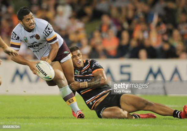 Anthony Milford of the Broncos looks to pass the ball during the round three NRL match between the Wests Tigers and the Brisbane Broncos at...