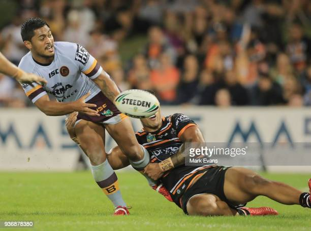 Anthony Milford of the Broncos passes the ball during the round three NRL match between the Wests Tigers and the Brisbane Broncos at Campbelltown...