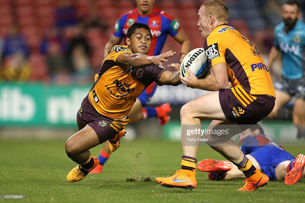 Anthony Milford of the Broncos passes the ball to team mate Jack Reed during the round 11 NRL match between the Newcastle Knights and the Brisbane Broncos at Hunter Stadium on May 25, 2015 in Newcastle, Australia.