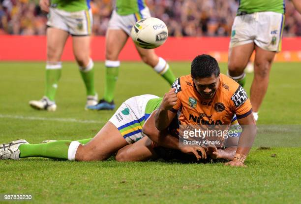 Anthony Milford of the Broncos scores a try during the round 16 NRL match between the Brisbane Broncos and the Canberra Raiders at Suncorp Stadium on...