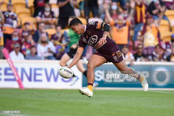 Anthony Milford of the Broncos scores a try during the round 25 NRL match between the Brisbane Broncos and the Newcastle Knights at Suncorp Stadium,...