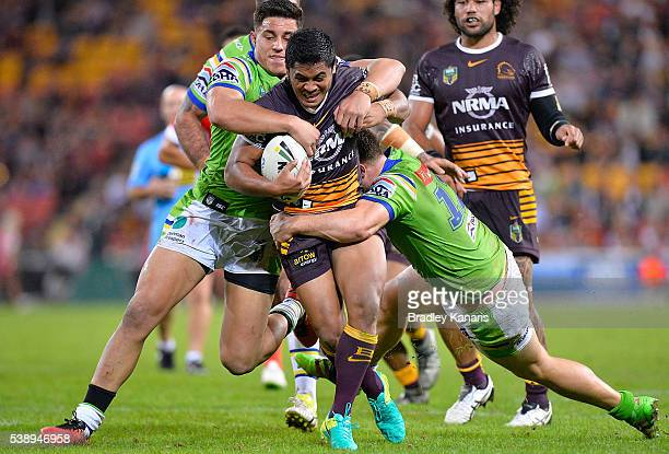Anthony Milford of the Broncos takes on the defence during the round 14 NRL match between the Brisbane Broncos and the Canberra Raiders at Suncorp...