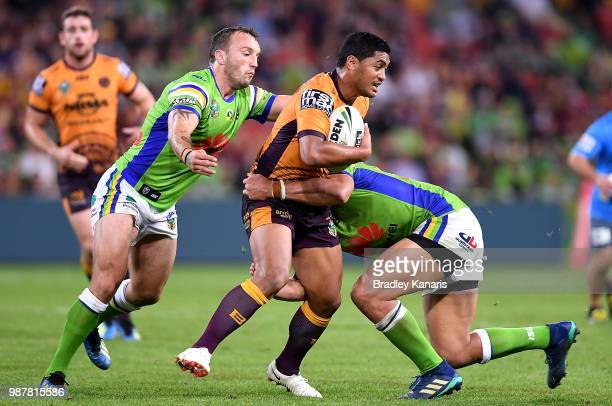 Anthony Milford of the Broncos takes on the defence during the round 16 NRL match between the Brisbane Broncos and the Canberra Raiders at Suncorp...