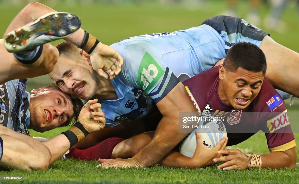 Anthony Milford of the Maroons is tackled by Angus Crichton of the Blues and Reagan Campbell-Gillard of the Blues during game one of the State Of Origin series between the Queensland Maroons and the New South Wales Blues at the Melbourne Cricket Ground on June 6, 2018 in Melbourne, Australia.