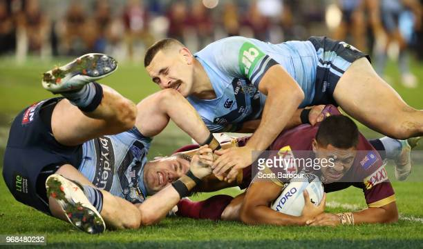 Anthony Milford of the Maroons is tackled by Angus Crichton of the Blues and Reagan CampbellGillard of the Blues during game one of the State Of...