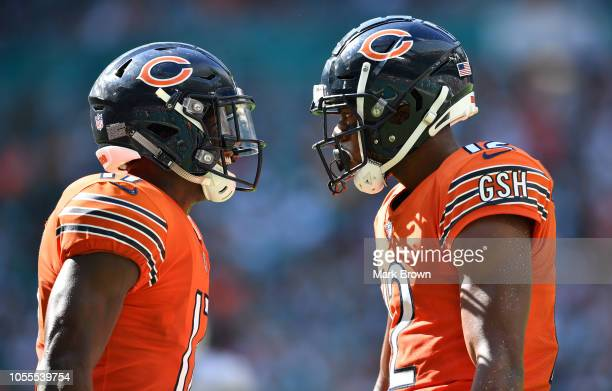 Anthony Miller and Allen Robinson of the Chicago Bears in action against the Miami Dolphins at Hard Rock Stadium on October 14 2018 in Miami Florida