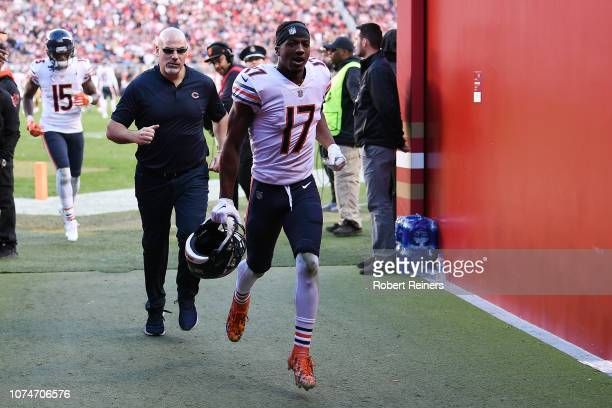 Anthony Miller and Josh Bellamy of the Chicago Bears run off the field after being ejected for unsportsmanlike conduct against the San Francisco...