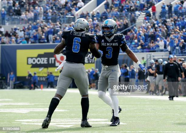Anthony Miller and Patrick Taylor Jr #6 of the Memphis Tigers celebrate against the SMU Mustangs on November 18 2017 at Liberty Bowl Memorial Stadium...