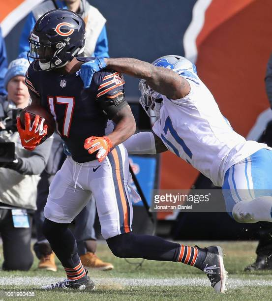 Anthony Miller of the Chicago Bears breaks away from Glover Quin of the Detroit Lions on his way to scoring a touchdwon at Soldier Field on November...