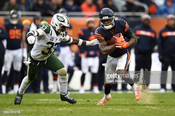 Anthony Miller of the Chicago Bears carries the football against Jamal Adams of the New York Jets in the fourth quarter at Soldier Field on October...