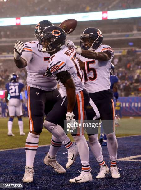 Anthony Miller of the Chicago Bears celebrates his touchdown in the final seconds of regulation play with teammates Bobby Massie and Josh Bellamy to...