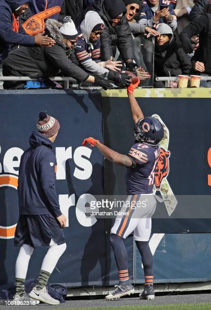Anthony Miller of the Chicago Bears gives the ball to fans after scoring a touchdown against the Detroit Lions at Soldier Field on November 11 2018...