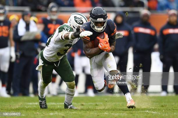 Anthony Miller of the Chicago Bears is brought down by Jamal Adams of the New York Jets during a game at Soldier Field on October 28 2018 in Chicago...