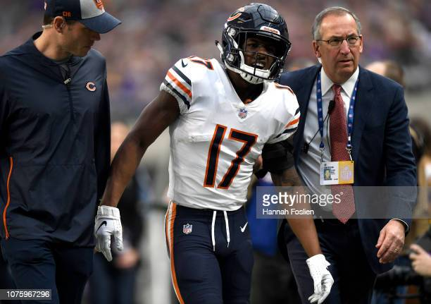 Anthony Miller of the Chicago Bears is helped off the field after injuring his shoulder on a play in the first quarter of the game against the...