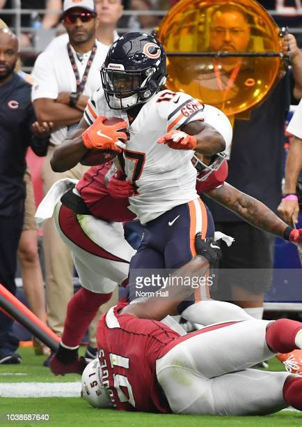 Anthony Miller of the Chicago Bears is tackled by Gerald Hodges and Antoine Bethea of the Arizona Cardinals during the first half at State Farm...